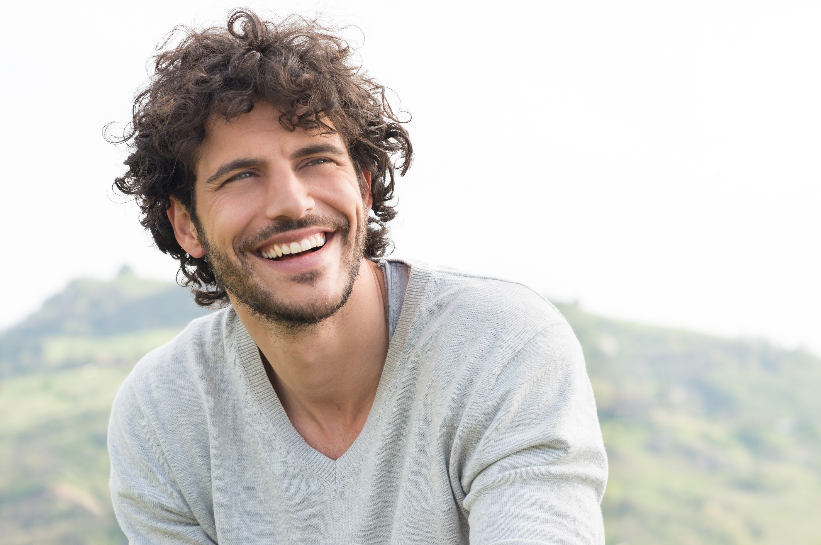 Portrait Of Young Handsome Man Smiling Outdoor